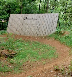 Hunter McFerrin/Herald-Leader For those capable of using them, this is one of several wall-ride features that exist on the mountain bike trails near city lake.
