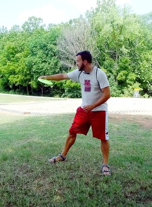 Lynn Atkins/The Weekly Vista Chris Griesenauer believes the new disc golf course at Branchwood is a great addition to Bella Vista amenities. Anyone can play disc golf, he said, and it's a very scenic course.