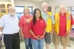 Westside Eagle Observer/SUSAN HOLLAND Jeff Davis (left) poses with new officers of the Gravette Lions Club. They are Melissa Steele, secretary-treasurer; Cela Gaytan, tail twister, Lion tamer and director; Al Blair, president; and Bill Mattler, director. Davis, Lions Club second vice district governor, installed the new officers at the club's July 3 meeting.