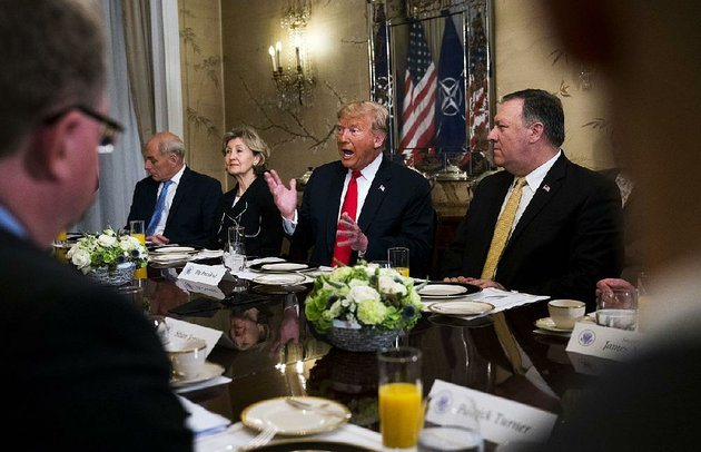 president-donald-trump-addresses-nato-secretary-general-jens-stoltenberg-unseen-during-a-breakfast-meeting-wednesday-in-brussels-also-attended-by-chief-of-staff-john-kelly-left-us-ambassador-to-nato-kay-bailey-hutchison-and-secretary-of-state-mike-pompeo