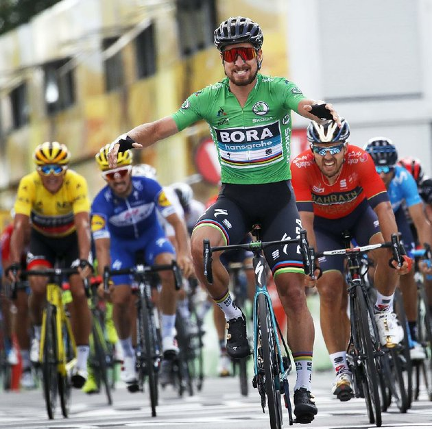 slovakias-peter-sagan-wearing-the-best-sprinters-green-jersey-wearing-the-best-sprinters-green-jersey-crosses-the-finish-line-in-quimper-france-to-win-wednesdays-fifth-stage-of-the-tour-de-france-belgiums-greg-van-avermaet-maintained-the-overall-lead-by-2-seconds-over-american-tejay-van-garderen