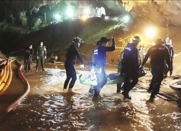an-undated-photo-released-wednesday-by-thai-navy-seals-shows-rescuers-holding-an-evacuated-boy-inside-the-tham-luang-nang-non-cave