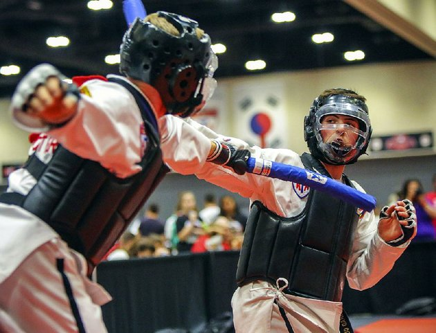 brad-clemens-right-of-painsville-ohio-and-andrew-vorster-of-mckinney-texas-compete-in-combat-sparring-at-a-previous-american-taekwondo-association-world-expo-this-years-expo-continues-through-sunday-at-little-rocks-statehouse-convention-center