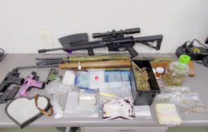 COURTESY PHOTO The controlled substances and paraphernalia pictured above were discovered while serving a search warrant on Narrows Lane, east of Noel, last week.