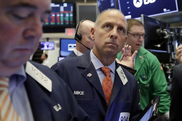 trader-michael-urkonis-center-works-on-the-floor-of-the-new-york-stock-exchange-wednesday-july-11-2018-stocks-are-opening-lower-on-wall-street-following-declines-in-europe-and-asia-after-washington-threatened-to-expand-tariffs-on-beijing-and-china-said-it-would-retaliate-ap-photorichard-drew