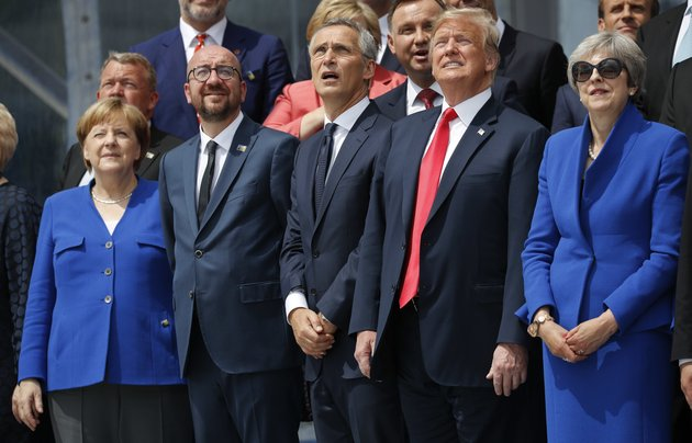 from-left-to-right-german-chancellor-angela-merkel-belgiums-prime-minister-charles-michel-nato-secretary-general-jens-stoltenberg-president-donald-trump-and-britains-prime-minister-theresa-may-look-up-in-sky-during-a-ceremonial-fly-over-ahead-of-the-opening-ceremony-of-the-nato-north-atlantic-treaty-organization-summit-at-the-nato-headquarters-in-brussels-wednesday-july-11-2018ap-photopablo-martinez-monsivais