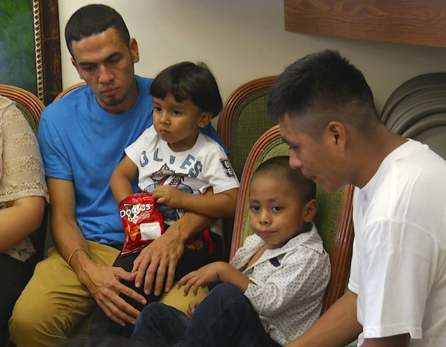 in-this-image-taken-from-video-javier-garrido-martinez-left-and-alan-garcia-right-sit-with-their-4-year-sons-at-a-news-conference-in-new-york-wednesday-july-11-2018-they-men-were-reunited-with-their-children-after-almost-two-months-of-separation-authorities-took-their-boys-them-when-they-stopped-at-the-us-southern-border-ap-photorobert-bumsted