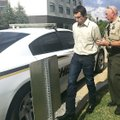 Charles Rickman, 31, is taken from Benton County court Tuesday after the first day of his jury tria...