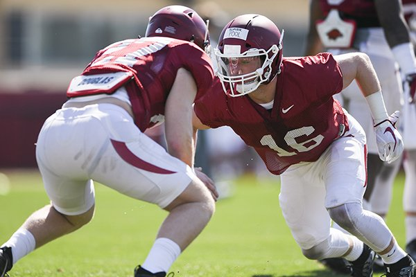 Arkansas linebacker Bumper Pool (16) goes through practice Saturday, March 3, 2018, in Fayetteville.