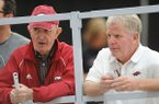 Former Arkansas coach John McDonnell (left) and current coach Chris Bucknam speak Saturday, Feb. 11, 2017, during the Tyson Invitational in the Randal Tyson Track Center in Fayetteville. Visit nwadg.com/photos to see more photographs from the meet.