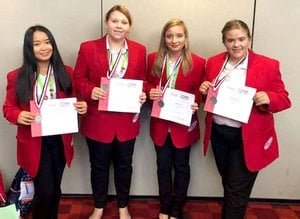 Westside Eagle Observer/SUBMITTED Members of the Decatur FCCLA show off their certificates and medals after taking a silver medal in Parliamentary Procedure competition during the national convention in Atlanta, Ga. July 2. Participating in the week-long convention were Emmy Lee, Kara Gregory, Tabby Tilley and Alisun Watson.