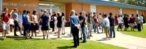 Westside Eagle Observer/MIKE ECKELS Several Decatur High School students mill around the main entrance to the high school Aug. 21, 2017, after viewing a solar eclipse. Students will walk through the doors at Decatur High School for the 2018-19 school year which begins Aug. 13.