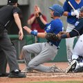 Northwest Arkansas' Xavier Fernandez tags Tulsa's Tyler Goeddel at home plate Sunday at Arvest Ballp...