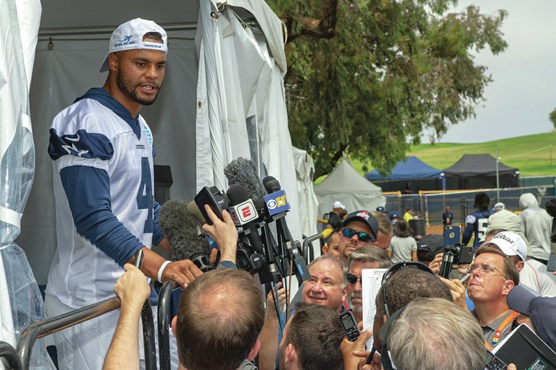 fa78d53c1 Dallas Cowboys quarterback Dak Prescott takes questions from the media  after the morning walk through practice during NFL training camp, Friday,  July 27, ...