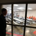 Deputy Chance Gregory watches inmates in May 2017 at the Benton County Jail in Bentonville. The Sher...