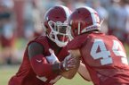 Arkansas defensive back Joseph Foucha (left) works through a drill with Dameron Vail Friday, Aug. 3, 2018, during practice at the university practice field on campus in Fayetteville.