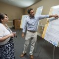 Ben Cline, public relations specialist for Rogers, talks to Angela Argueta of Rogers Wednesday durin...