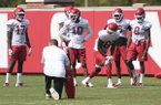 The wide receivers run drills Monday August 6, 2018 during practice at the University of Arkansas in Fayetteville.