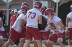 Arkansas offensive linemen Dalton Wagner (78) and Noah Gatlin (73) participate in a drill Friday, Aug. 3, 2018, during practice at the university practice field on campus in Fayetteville.