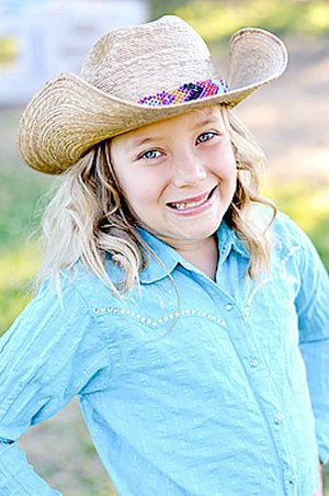 Submitted photo Emily Burke, 9, daughter of James Burke and Jennifer Bratton, of Watts, Okla., is a contestant for 2018 Lincoln Riding Club princess.