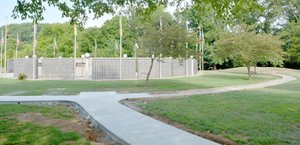 Keith Bryant/The Weekly Vista Concrete has started to appear for what will become a 1,000-foot, wheelchair accessible sidewalk next to the Veterans Wall of Honor. Outgoing veterans council president Gary Aaron said that the walkway, dubbed the Walk of Honor, will feature six benches. Funding for the project was provided by Lowe's, Cooper Communities and the POA.