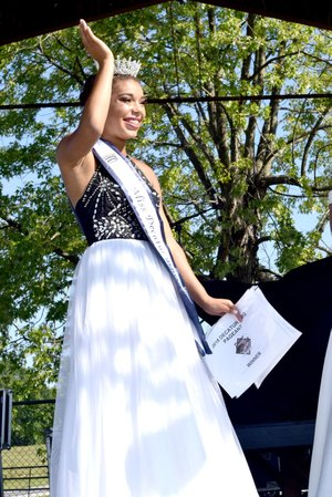 Westside Eagle Observer/MIKE ECKELS Desi Meek from Decatur won the 65th Miss Decatur Barbecue title at Veterans Park in Decatur Aug. 4.