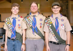 Hunter McFerrin/Herald-Leader The newest Eagle Scouts from Troop 84 in Siloam Springs held their Eagle Ceremony on Aug. 4 at New Life Ranch, in which three scouts were selected. Pictured, from left, are Nate Youmans, 16, Stephen Norwood, 18, Joseph Hahn, 18.