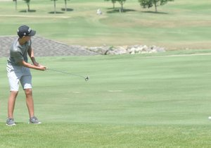 Neal Denton/Special to the Herald-Leader Siloam Springs junior Evan Sauer putts onto the green Monday at the Ultimate Auto Group High School Invitational at Big Creek Golf and Country Club in Mountain Home. The tournament continued on Tuesday. Results were not available at presstime.