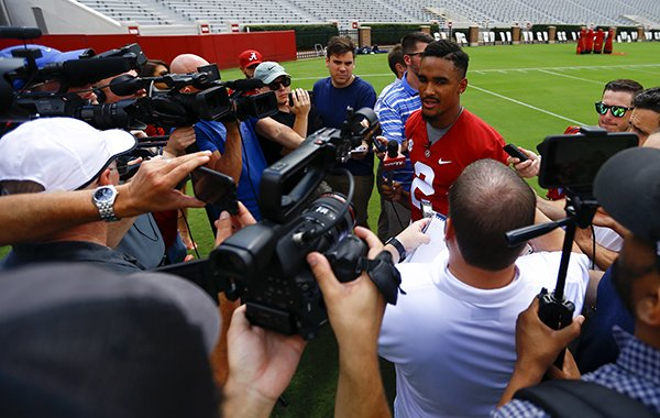 Alabama quarterback Jalen Hurts (2) speaks to media before a NCAA college football practice, Saturday, Aug. 4, 2018, in Tuscaloosa, Ala. (AP Photo/Butch Dill)