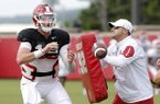 Arkansas offensive coordinator Joe Craddock, right, works with quarterback Cole Kelley during practice Wednesday, Aug. 8, 2018, in Fayetteville.