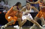 Arkansas' India Lewis guards Clemson's Kanetra Queen during the second half of an NCAA Tournament game on Friday, March 15, 2002, in Manhattan, Kan. The Razorbacks won 78-68.
