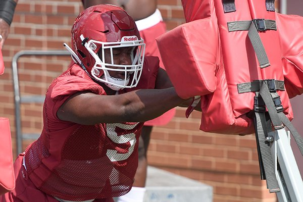 Arkansas defensive lineman Dorian Gerald goes through practice Monday, Aug. 6, 2018, in Fayetteville.