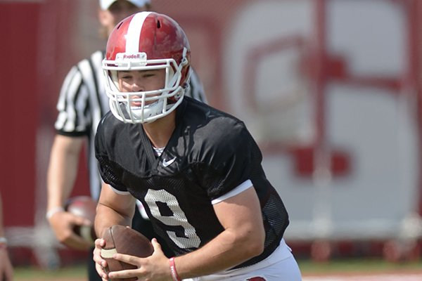 Arkansas quarterback John Stephen Jones rolls out to pass Thursday, Aug. 9, 2018, during practice at the university's practice facility in Fayetteville.