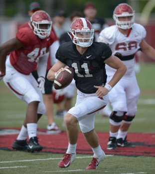 NWA Democrat-Gazette/Andy Shupe LOOKING FORWARD: Arkansas quarterback Daulton Hyatt rolls out to pass Thursday during practice at the university's practice facility in Fayetteville. Hyatt, along with Connor Noland and John Stephen Jones, took snaps with the Razorbacks first team in Thursday's practice.