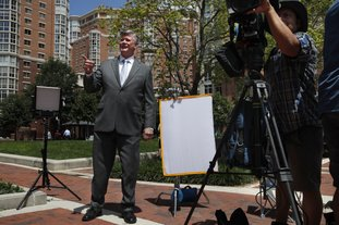 Attorney Kevin Downing, left, gestures to the rest of the defense team for Paul Manafort, as the team leaves federal court for a lunch break during the trial of the former Trump campaign chairman, in Alexandria, Va., Thursday, Aug. 9, 2018. (AP Photo/Jacquelyn Martin)