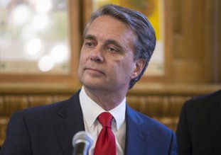 Kansas Governor Jeff Colyer talks to reporters in Topeka, Kan., on Wednesday, Aug. 8, 2018, a day after his primary race against Kansas Secretary of State Kris Kobach. (Travis Heying/The Wichita Eagle via AP)