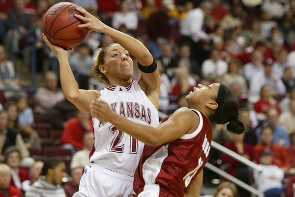 Arkansas' India Lewis shoots over the top of Alabama's Manisha Redus during the an SEC Tournament game Thursday, March 6, 2003, in North Little Rock. Arkansas won 53-48.