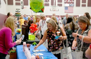 Janelle Jessen/Siloam Sunday Teachers and school employees visited the booths of local businesses during the annual Chamber of Commerce Back to School Breakfast on Wednesday morning.