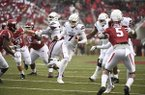 Mississippi State quarterback Nick Fitzgerald slips past the Arkansas defense to score a touchdown during the first half of an NCAA college football game Saturday, Nov. 18, 2017 in Fayetteville, Ark. (AP Photo/Michael Woods)