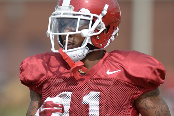 Arkansas defensive back Ryan Pulley participates in a drill Tuesday, Aug. 7, 2018, during practice at the university practice fields in Fayetteville.