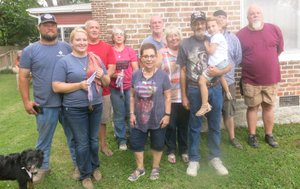 Westside Eagle Observer/SUSAN HOLLAND Winners in the sixth annual Gravette Day Dutch oven cook-off pose with their medals after competition awards were presented. Pictured are All Fired Up, Corey and Donna Taylor and Dax, third place winners; Pot Rasslers Kelley Sharp, Jane Beek and Jesse Beek, first place winners; Marilyn Munger, Margie and Marvin VanNoy and Emersyn, first place novice winners; and Culvercreek Posse, Jon and Jarren Tupper, second place winners.