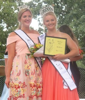 Westside Eagle Observer/SUSAN HOLLAND Isabella Dell, Miss Gravette 2017, poses with Darlene McVay, the newly crowned Miss Gravette 2018, at the conclusion of the Miss Gravette pageant Saturday evening. McVay was also chosen Miss Congeniality and was first in the evening gown and interview competitions.