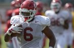Arkansas running back T.J. Hammonds carries the ball Thursday, Aug. 9, 2018, during practice at the university's practice facility in Fayetteville. Visit nwadg.com/photos to see more photos from practice.