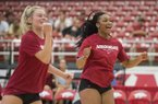 Allyson Dernehl (left) and Elizabeth Pamphile celebrate a point Saturday, Aug. 11, 2018, during the Arkansas volleyball Red-White Game at Barnhill Arena in Fayetteville.