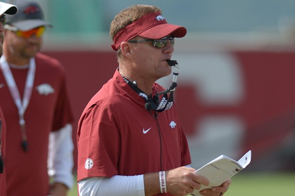 Arkansas coach Chad Morris directs his players Thursday, Aug. 9, 2018, during practice at the university's practice facility in Fayetteville.