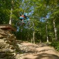 Jordan Sauls of Centerton launches off a drop on the Drop the Hammer trail Thursday, July 20, 2017, ...