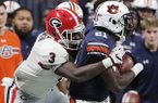 Georgia linebacker Roquan Smith (3) tackles Auburn running back Kerryon Johnson (21) during the second half of the Southeastern Conference championship NCAA college football game, Saturday, Dec. 2, 2017, in Atlanta. (AP Photo/David Goldman)