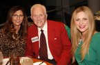 Betsy Broyles Arnold (left), Frank Broyles (center) and Molly Arnold are shown during a reception Dec. 8, 2015, at the Clinton Presidential Center in Little Rock.