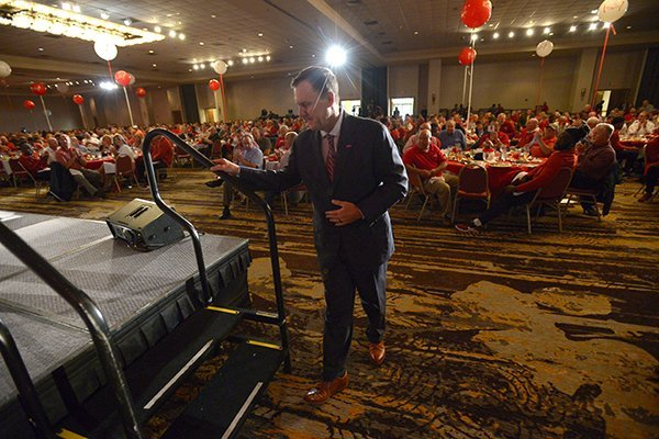 Arkansas coach Chad Morris walks onto the stage Friday, Aug. 17, 2018, as he is introduced during the annual Kickoff Luncheon at the Northwest Arkansas Convention Center in Springdale.
