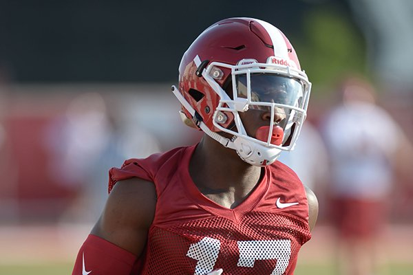 Arkansas defensive back Joseph Foucha participates in a drill Friday, Aug. 3, 2018, during practice at the university practice field on campus in Fayetteville.